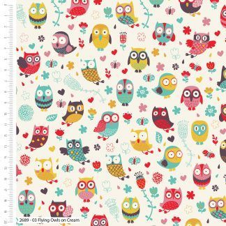 Craft Cotton Happy Owls Flying Multi coloured on a white background fabric. Bright Quilting